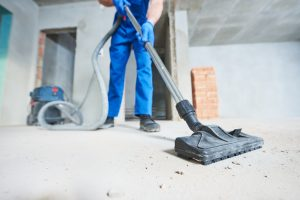 Man vacuuming for construction cleaning services